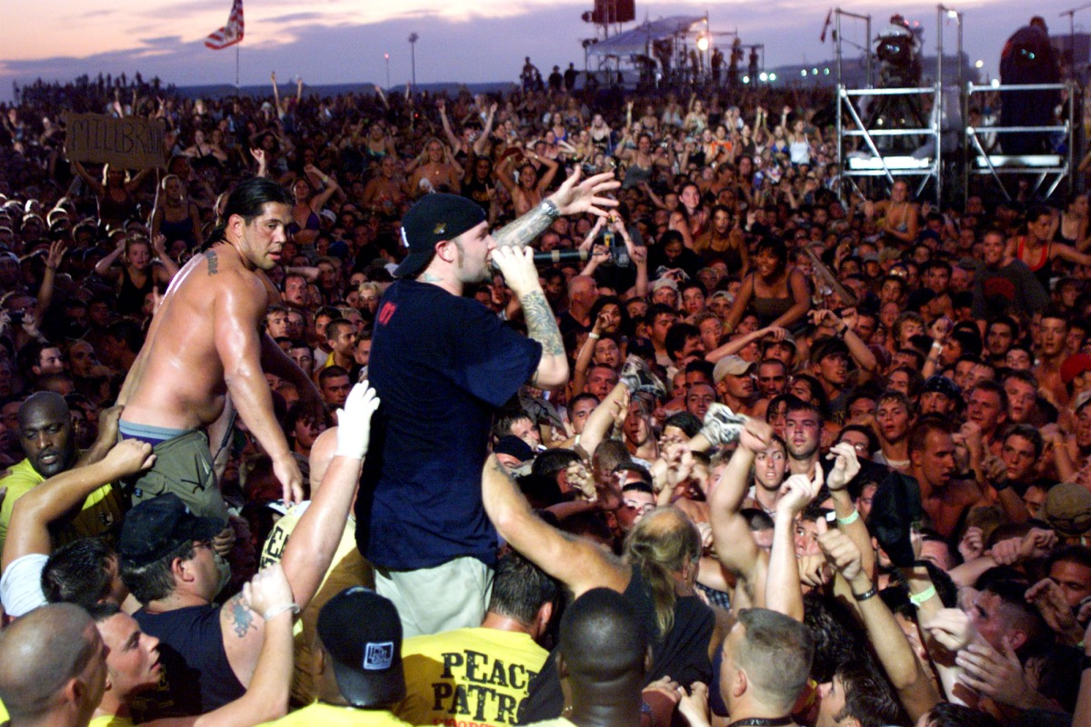 Limp Bizkit's Fred Durst brings his performance to the head of the crowd of the east stage Saturday at Woodstock '99 in Rome, New York