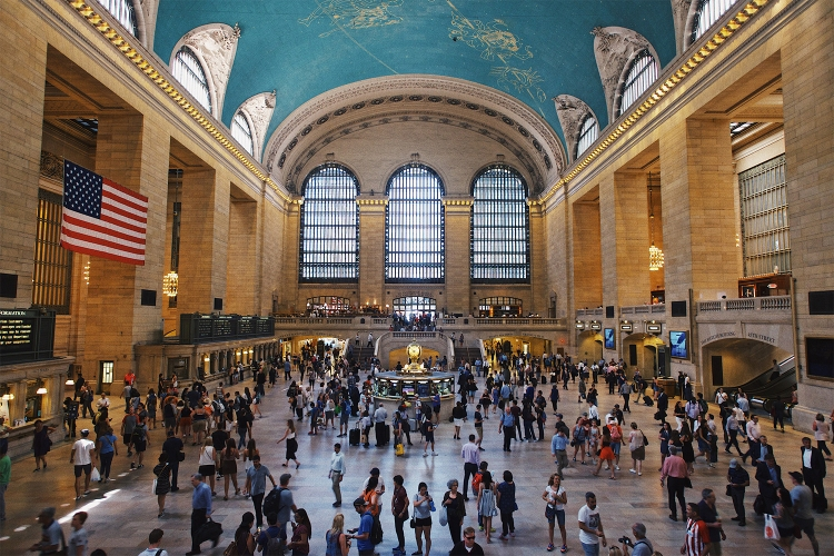 People walking around Grand Central Terminal during the day