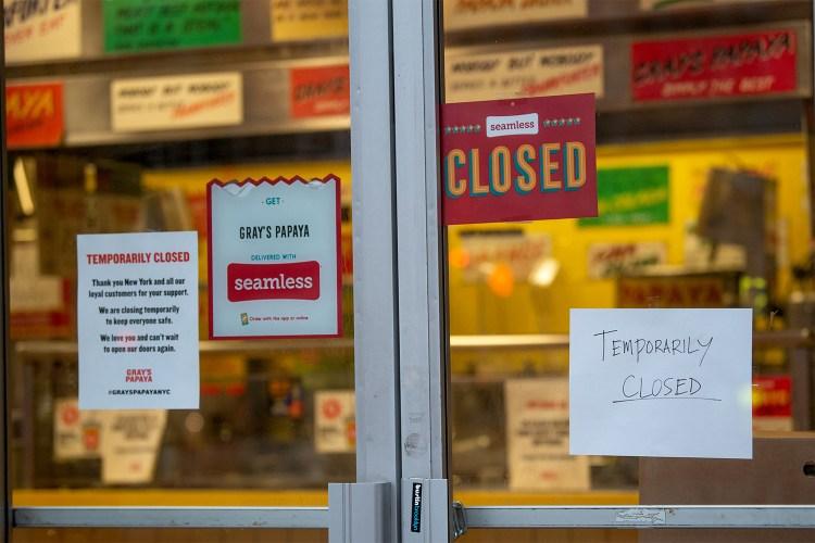 Closed signs hang on Gray's Papaya amid the coronavirus pandemic in New York City