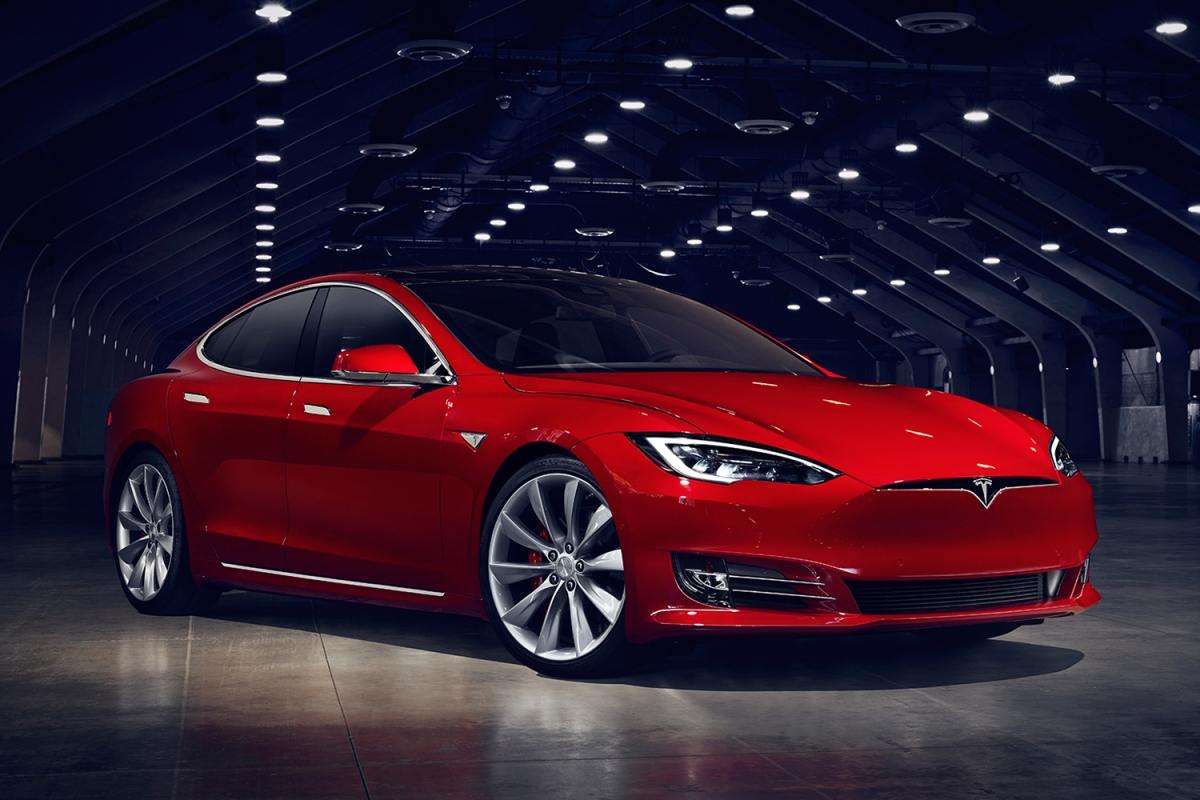 Red Tesla Model S electric sedan in a hangar