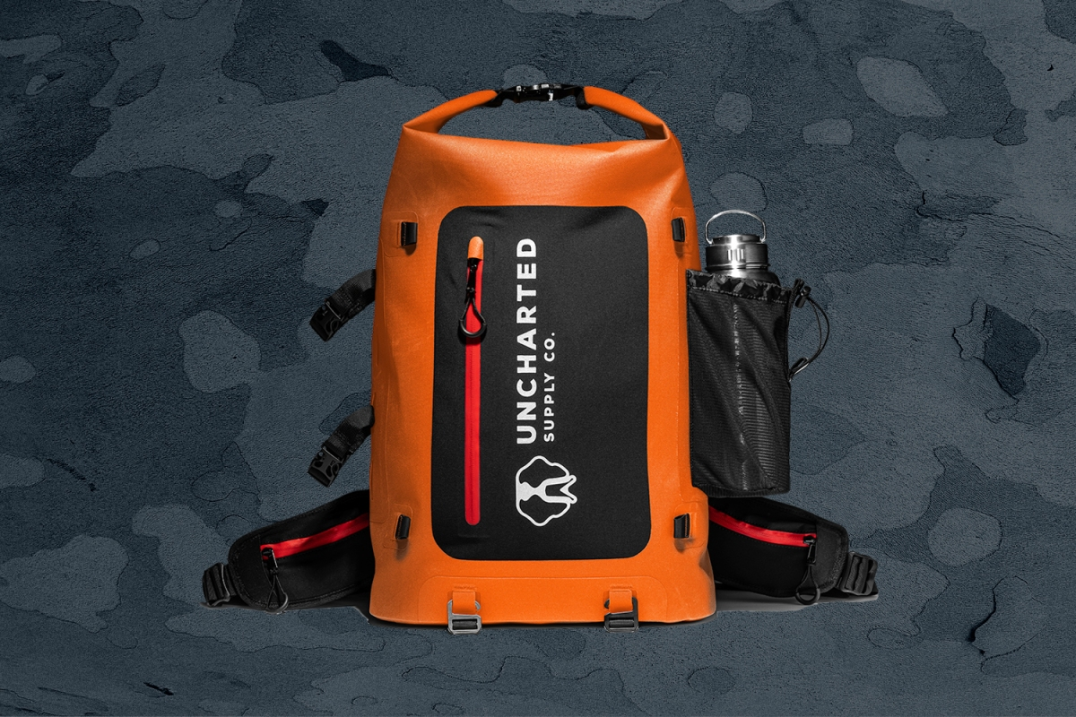 The orange Seventy2 Pro Survival System go bag from Uncharted Supply Co.