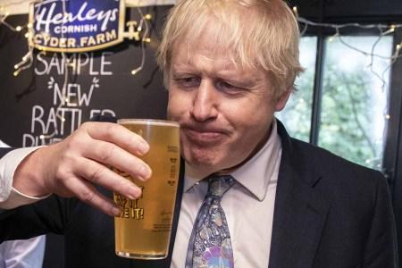 Boris Johnson drinking a beer