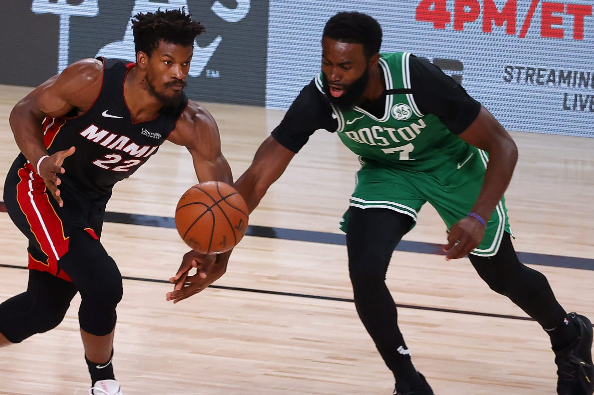 Jimmy Butler of the Miami Heat and Jaylen Brown of the Boston Celtics fight for a loose ball.