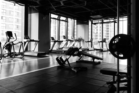 black and white photo of a gym with fitness equipment