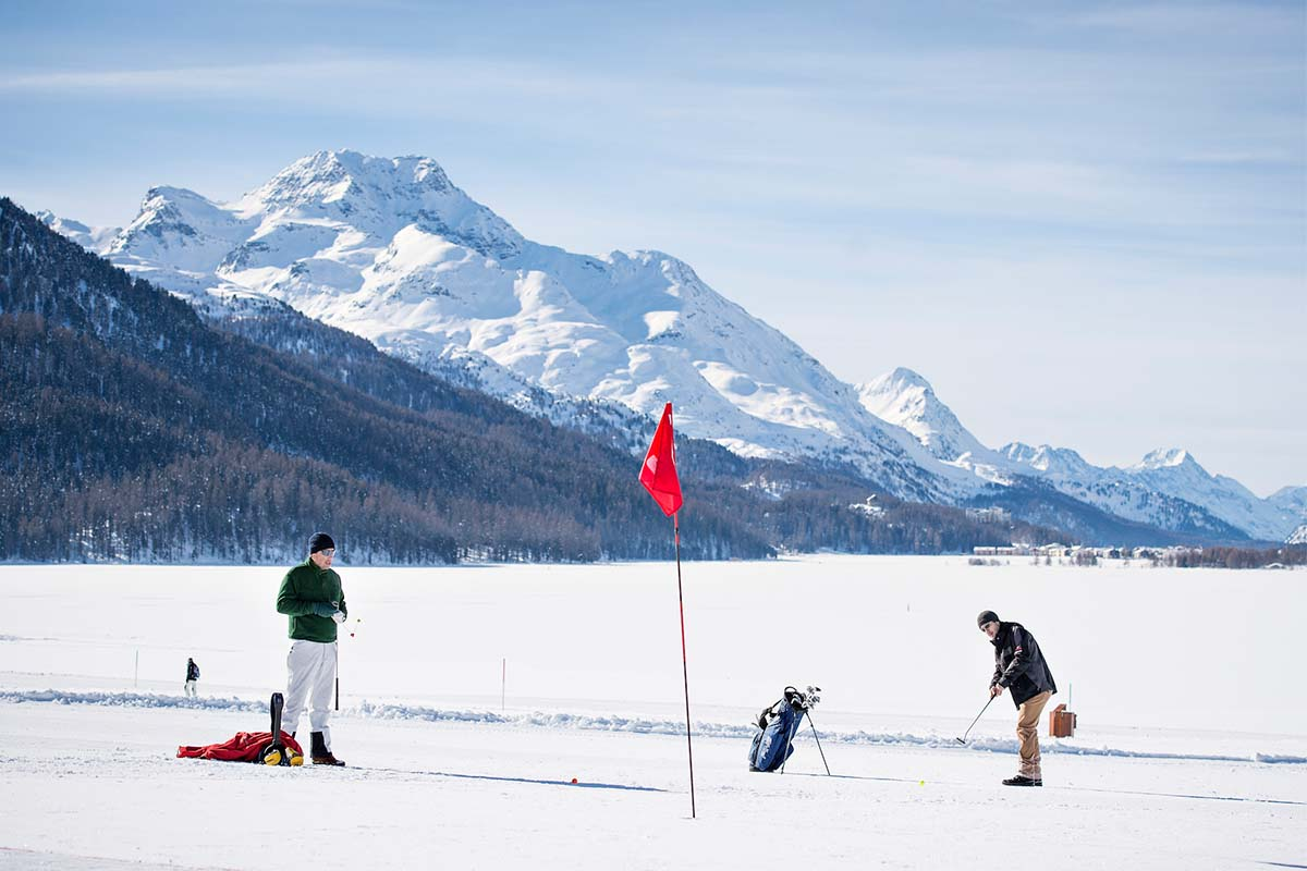 Two golfers playing snow golf at the Engadin Snow Golf Cup in Switzerland