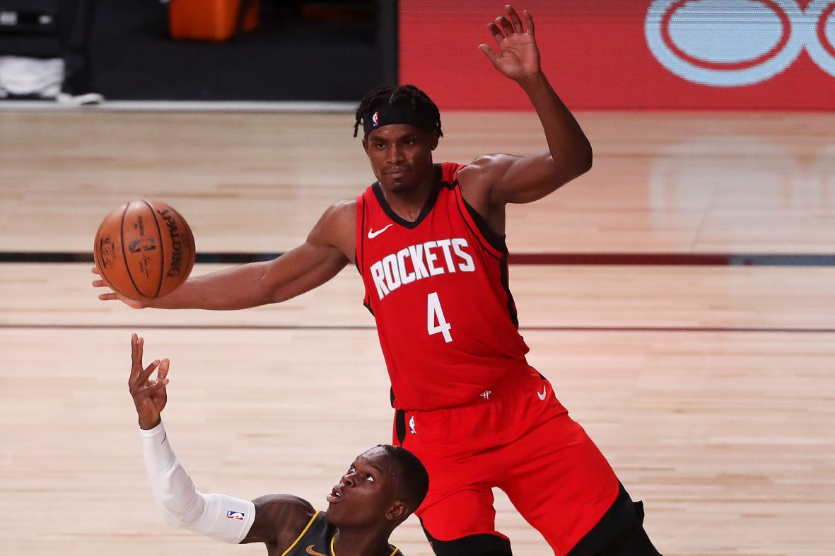 Danuel House Jr. of the Houston Rockets battles for the ball.