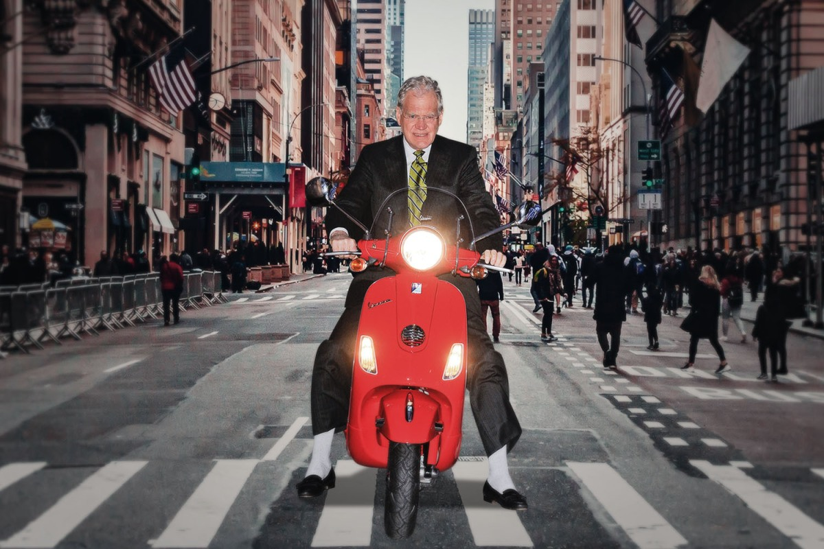 David Letterman riding a Vespa motor scooter in New York City