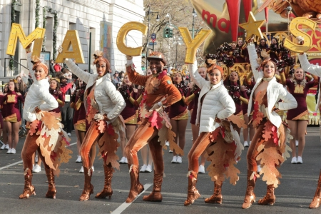 Dancers in turkey outfits during the 93rd Macy's Thanksgiving Day Parade on November 28, 2019 in New York City