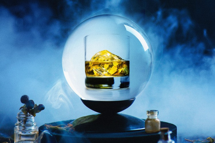 Crystal ball with occult equipment and mysterious smoke. Fortune-telling concept with copy space