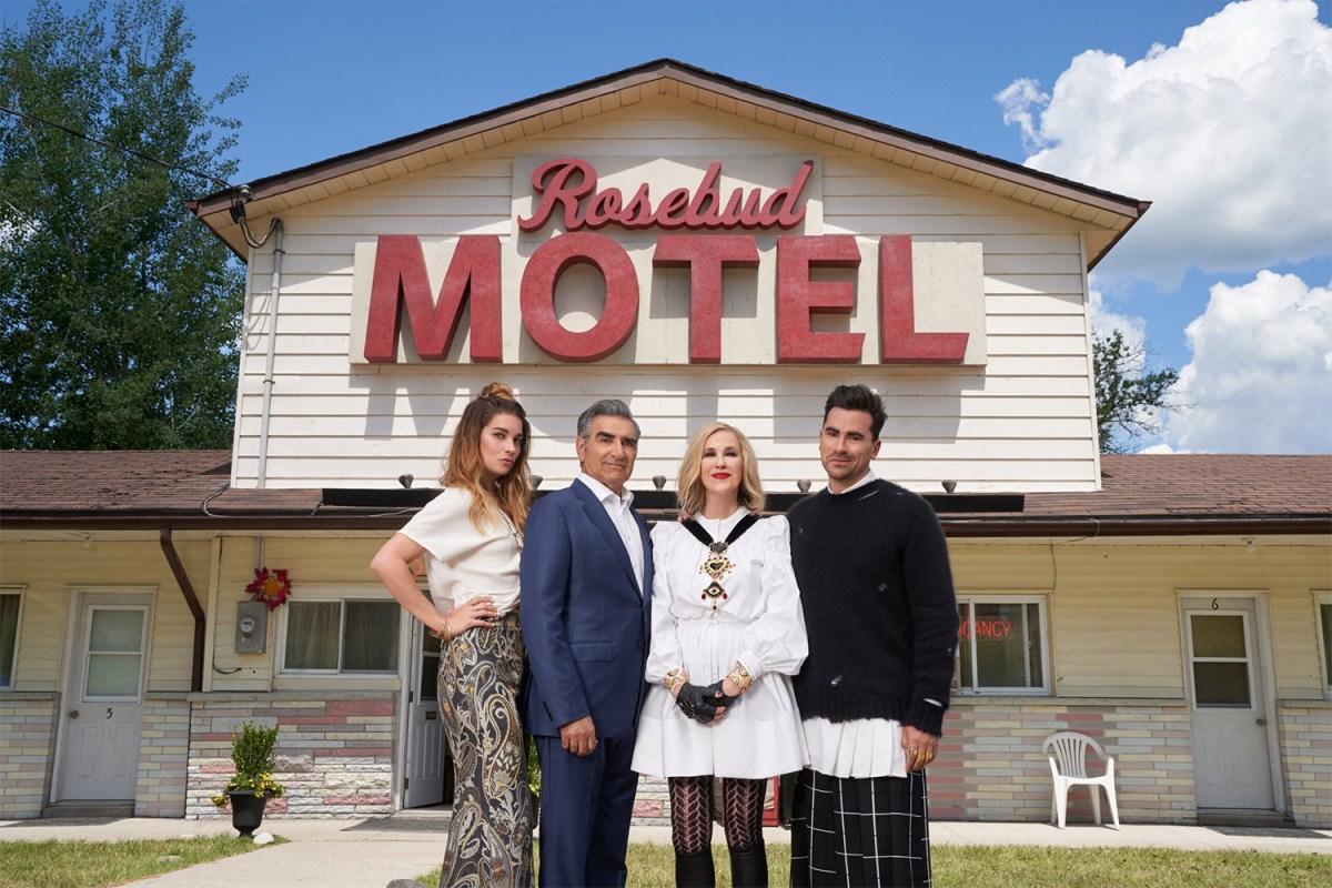 "The actors of ""Schitt's Creek"" in front of the Rosebud Motel"
