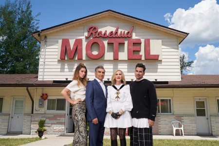 "The actors of ""Schitt's Creek"" in front of the Rosebud Motel"