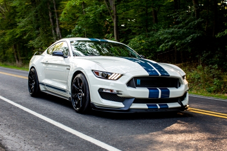 The 2020 Ford Mustang Shelby GT350R Heritage Edition in white and blue on the road