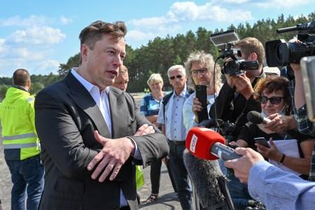 Tesla CEO Elon Musk talks to journalists in Germany