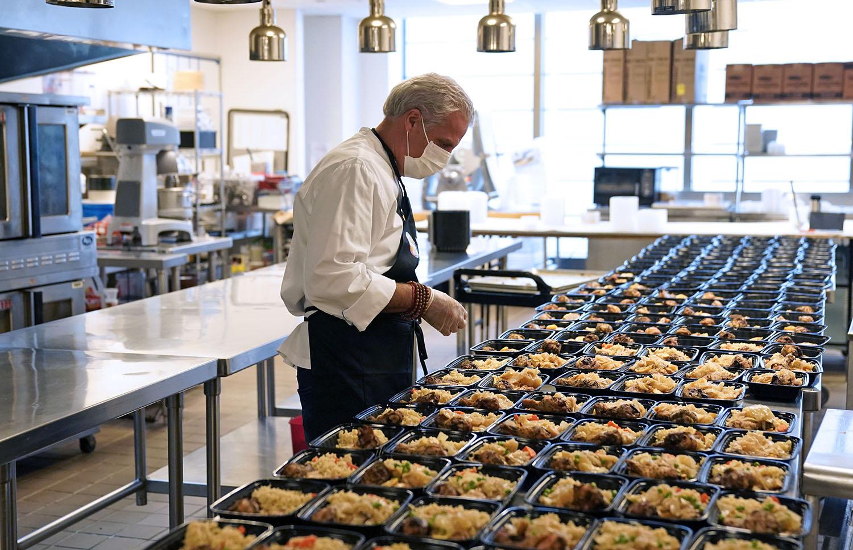 celebrity chef eric ripert prepares meal