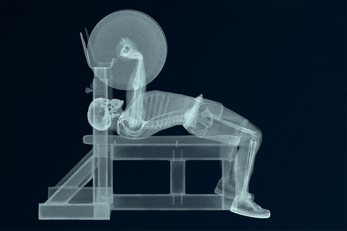 xray of man bench pressing