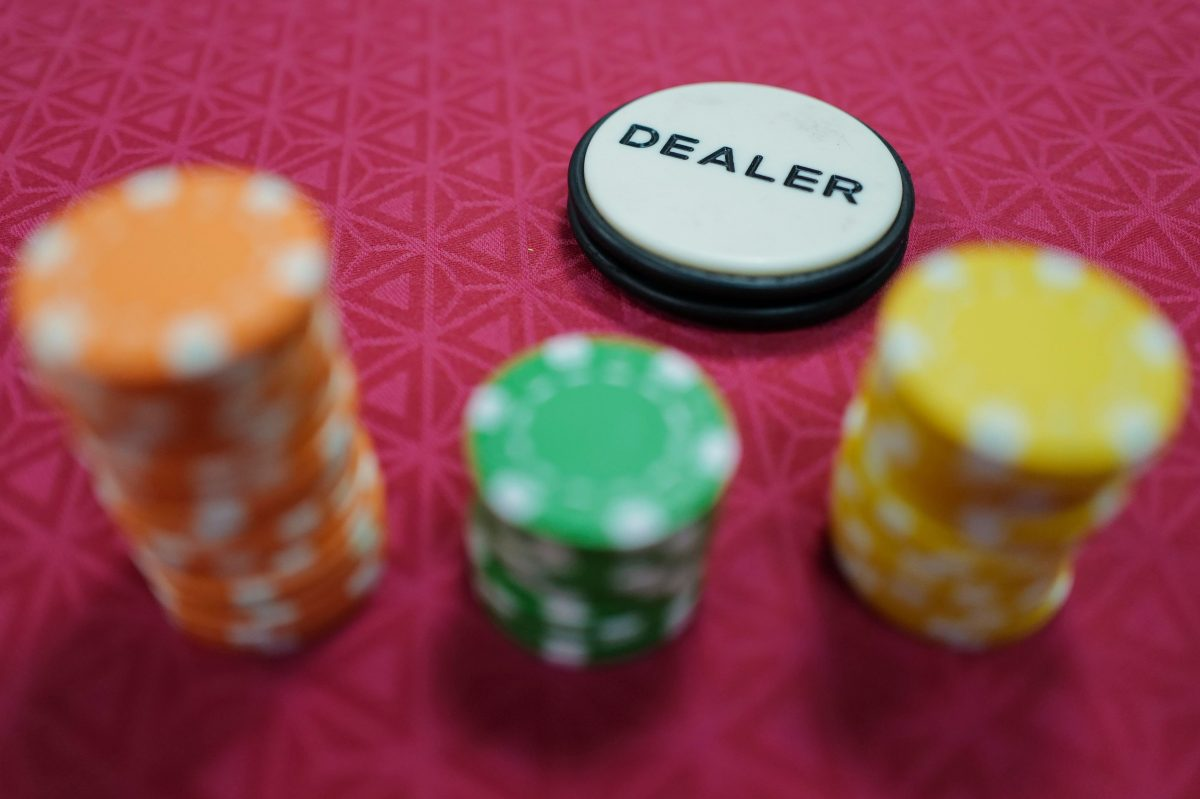 Poker gaming chips stand on a table during a casino training session in France.