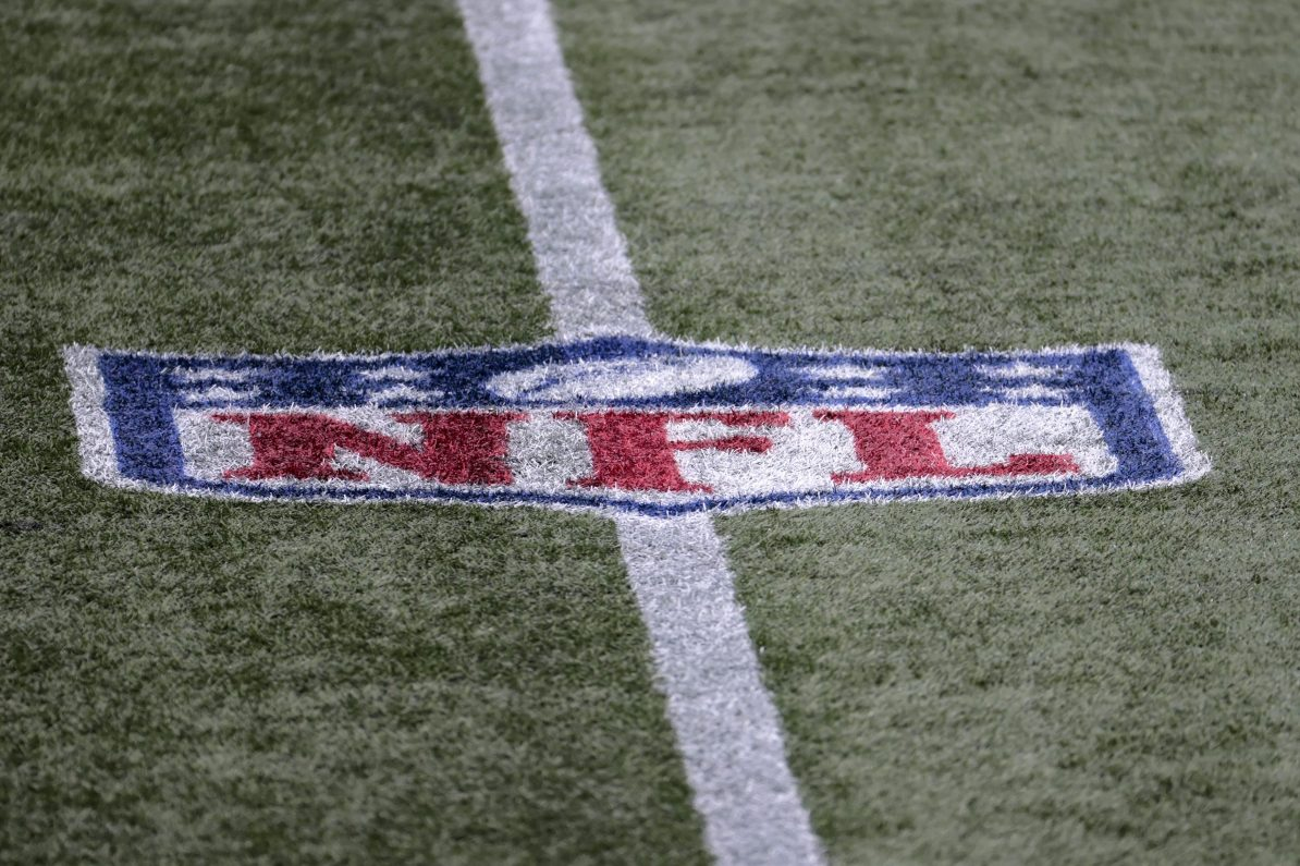 NFL logo on the field during a game between the Patriots and Raiders.