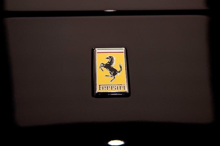Ferrari logo on black sports car