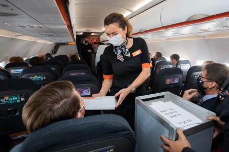 masked flight attendant