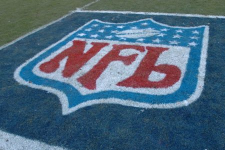 The NFL logo covers part of the field during a game.
