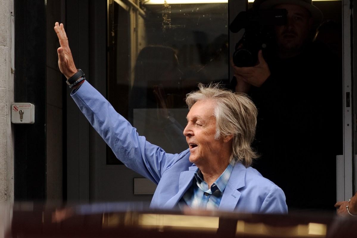 Paul McCartney waving