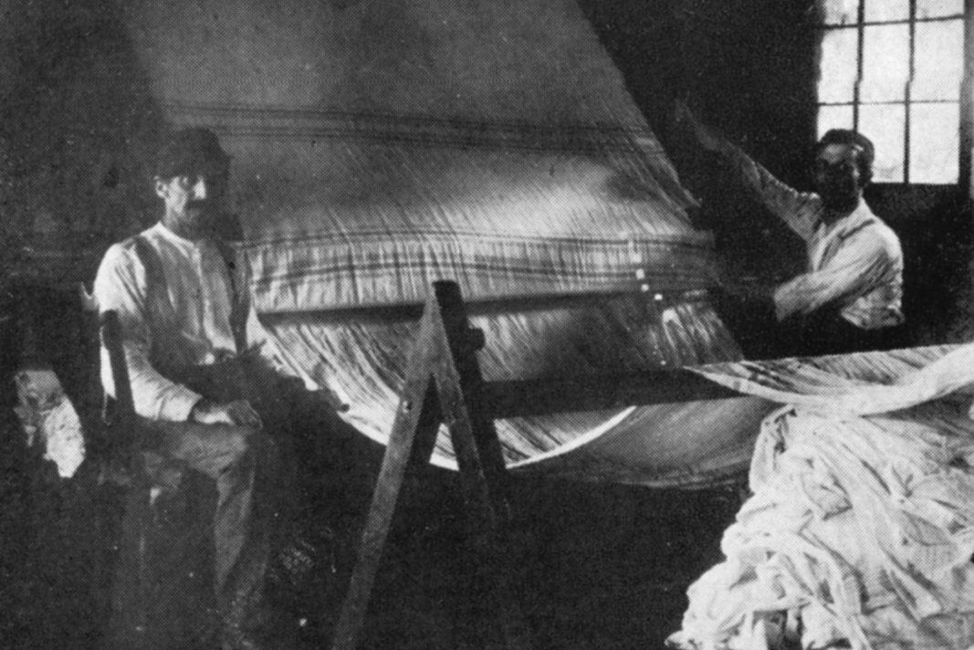 Men at a loom