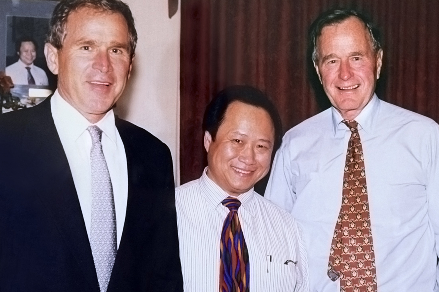 Presidents George Bush and George W. Bush with the owner of Peking Gourmet Inn.