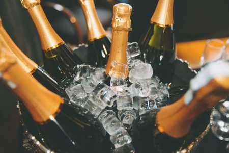Bottles Of Champagne In Ice Bucket