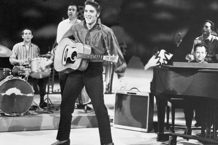 elvis presley playing guitar