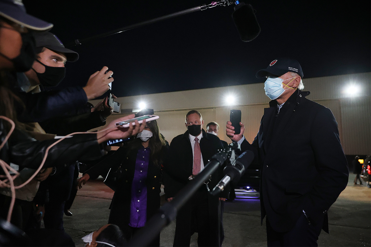Biden wearing two masks