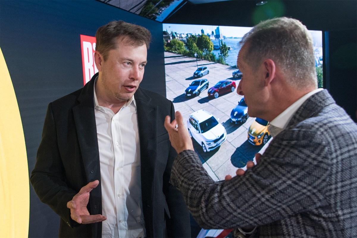 Tesla CEO Elon Musk and Volkswagen's Herbert Diess