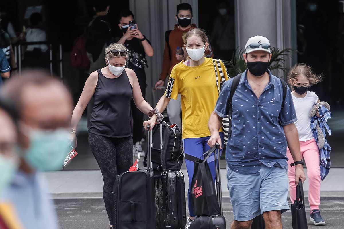 Bali tourists wearing masks
