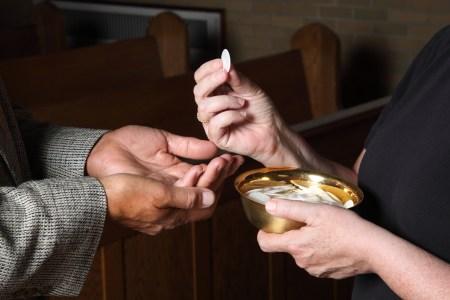 woman serving communion