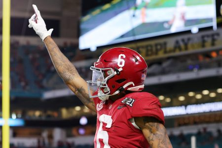 DeVonta Smith of the Alabama Crimson Tide celebrates a touchdown  at College Football Playoff National Championship game.