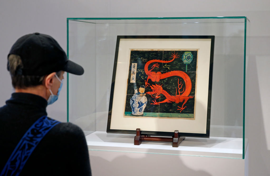 Cover Of The 1936 Album Le Lotus Bleu By Herge Is Displayed At Artcurial Auction House In Paris