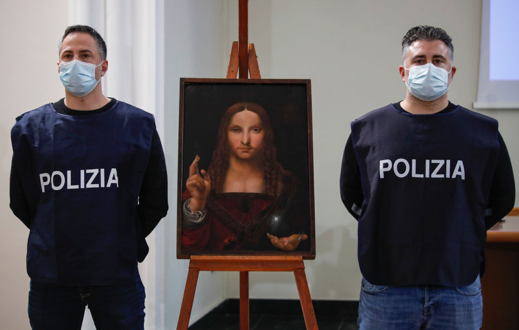 "Policeman show the ""Salvator Mundi"", a painting from the"