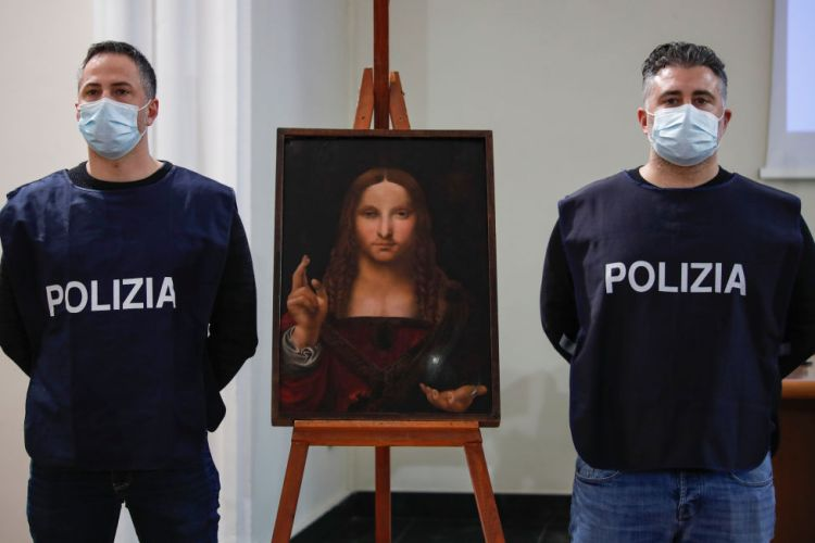 """Policeman show the """"Salvator Mundi"""", a painting from the"""