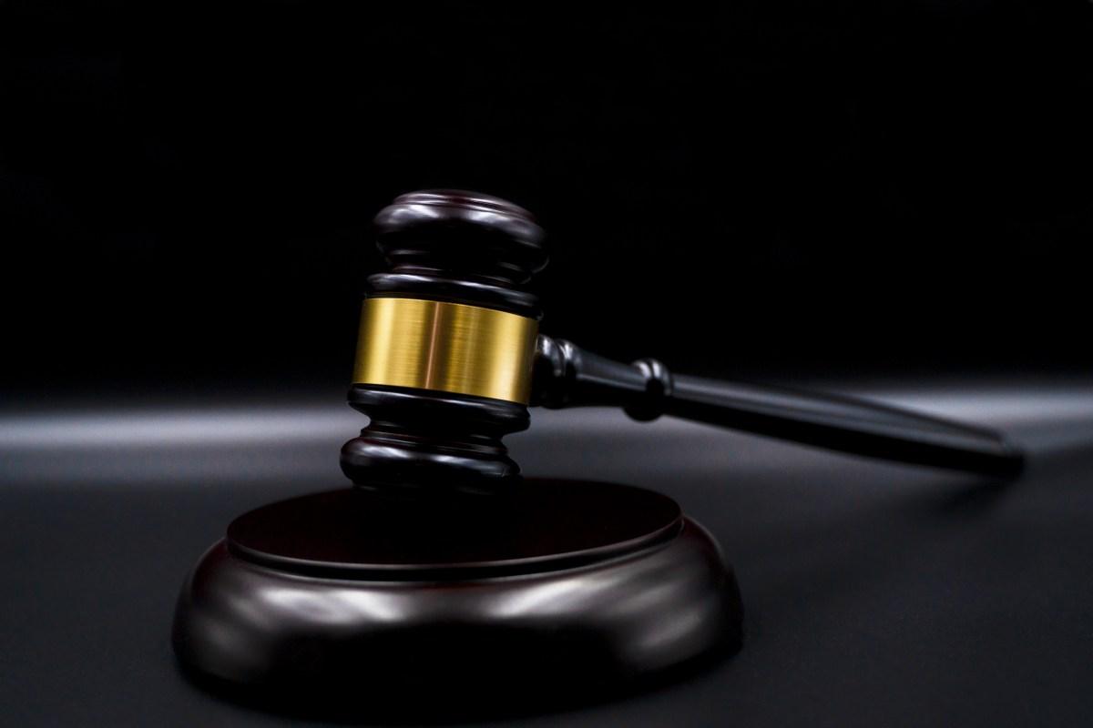 Wooden court gavel on black background