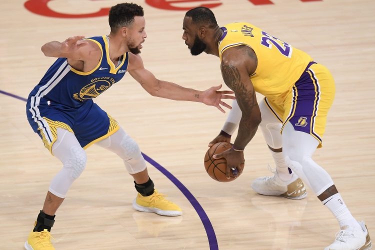 LeBron James drives on Stephen Curry