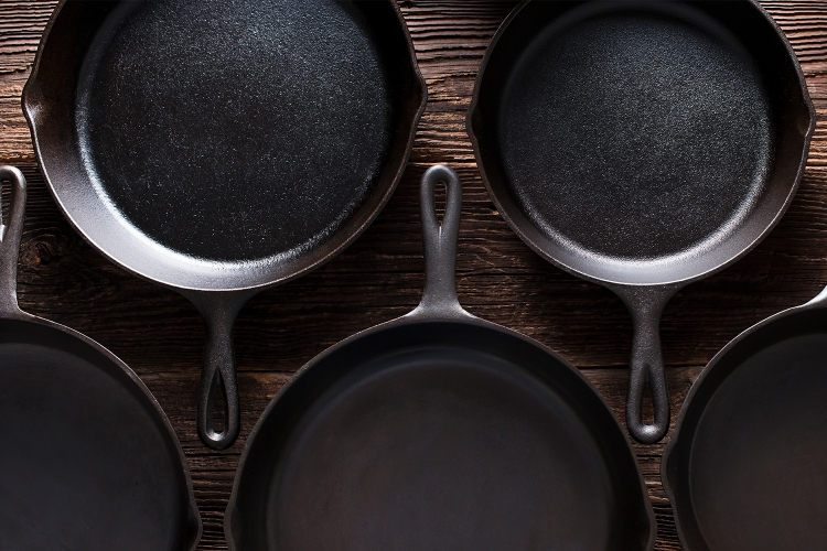 Cast iron skillets on a table