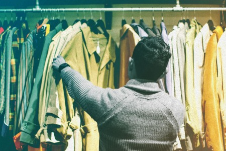 man shopping for vintage clothes