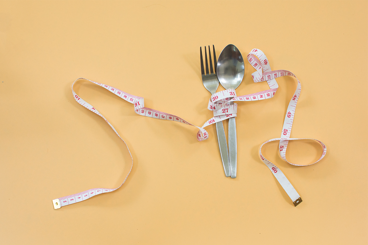 fork and spoon with a tape measure