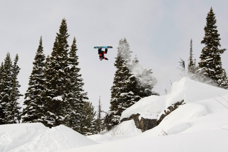 Travis Rice jumps over Pine Island during day 1 qualifiers of the Natural Selection Tour at Jackson Hole Mountain Resort in Jackson, Wyoming, USA, on 16 February, 2021