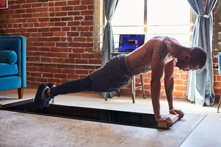 Slide Boards Are the Most Underrated Home Workout Apparatus We've Tried
