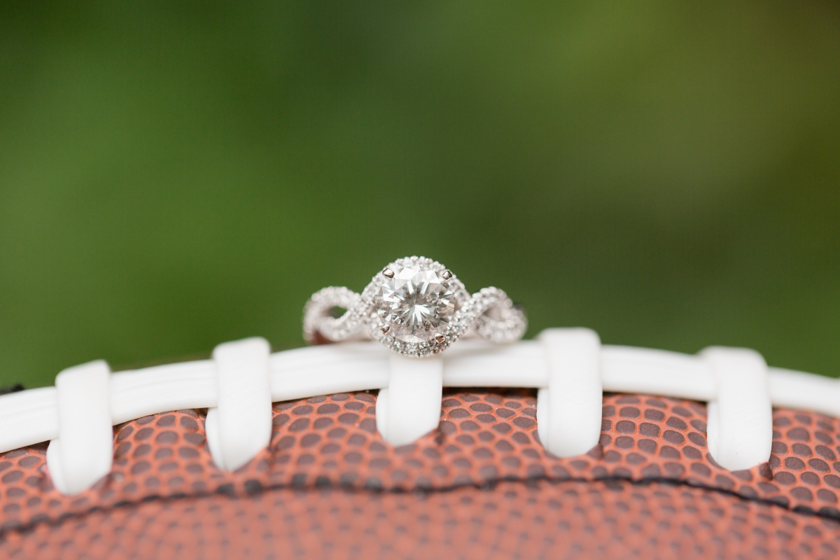 engagement ring resting on football