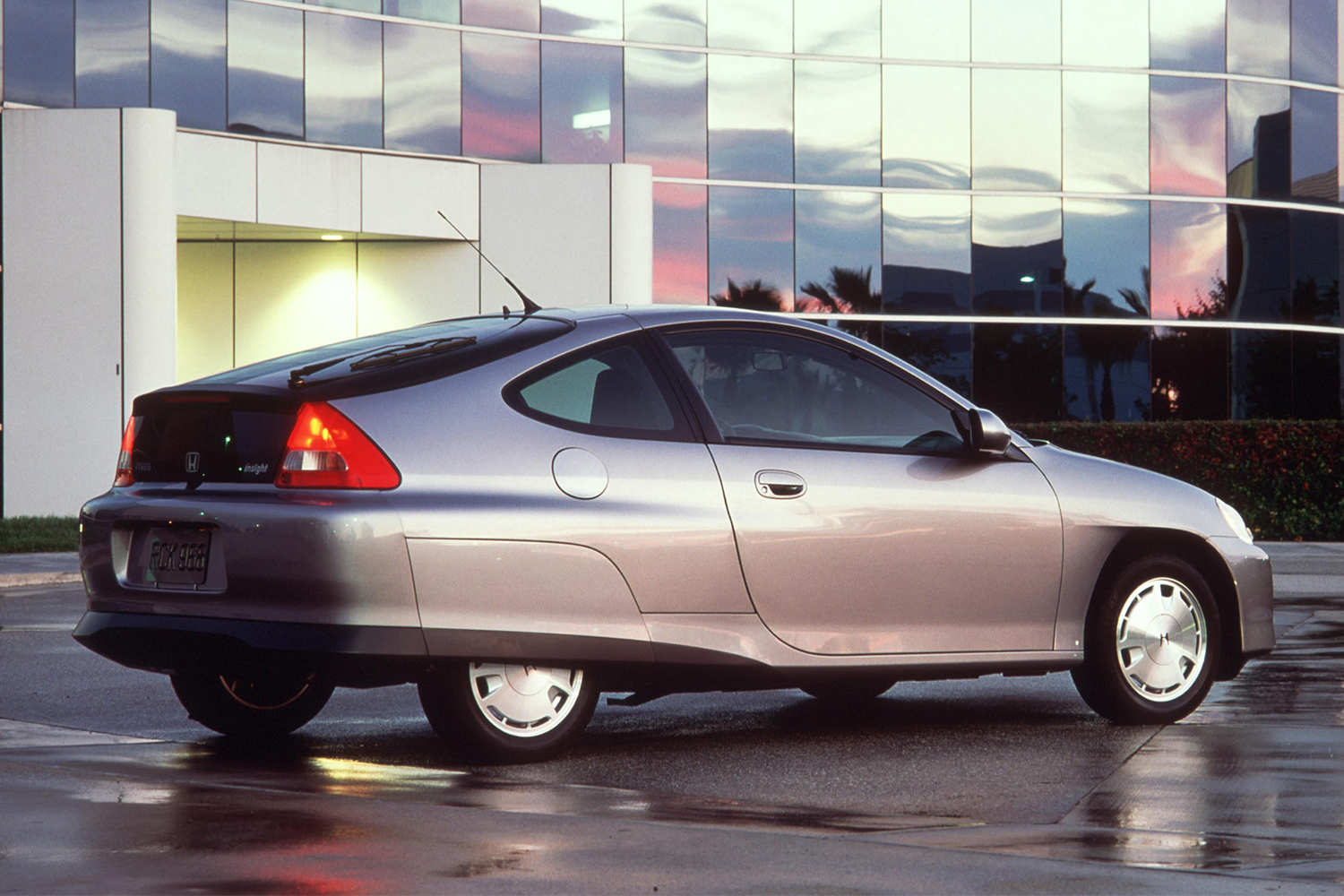 The back end of the 2000 Honda Insight hybrid in silver