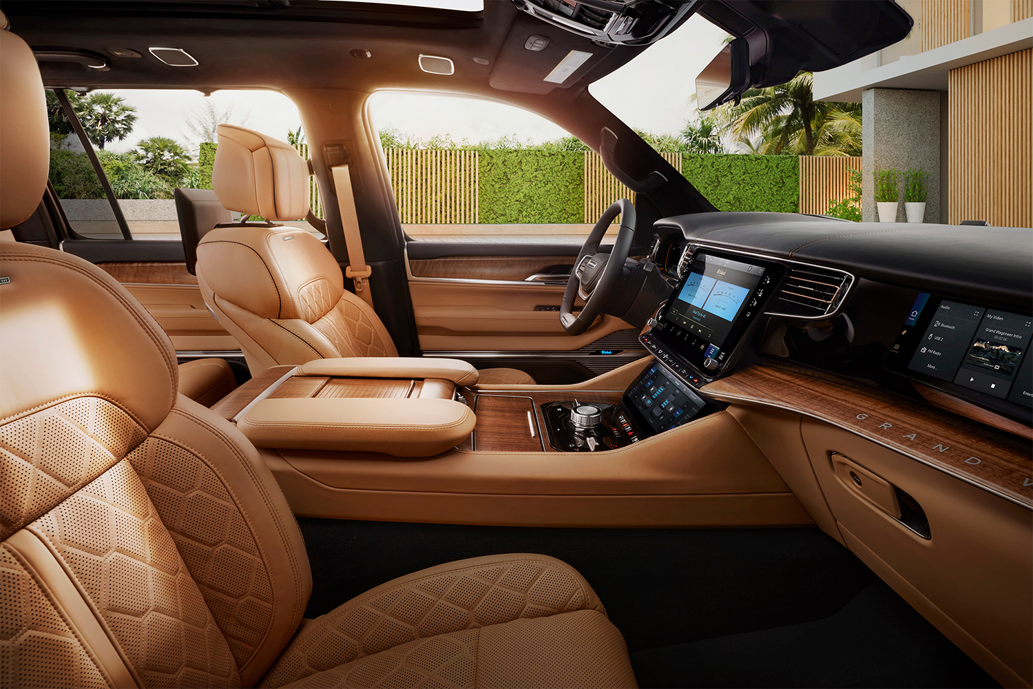 The leather and wood accented interior of the 2022 Jeep Grand Wagoneer shot from the passenger seat