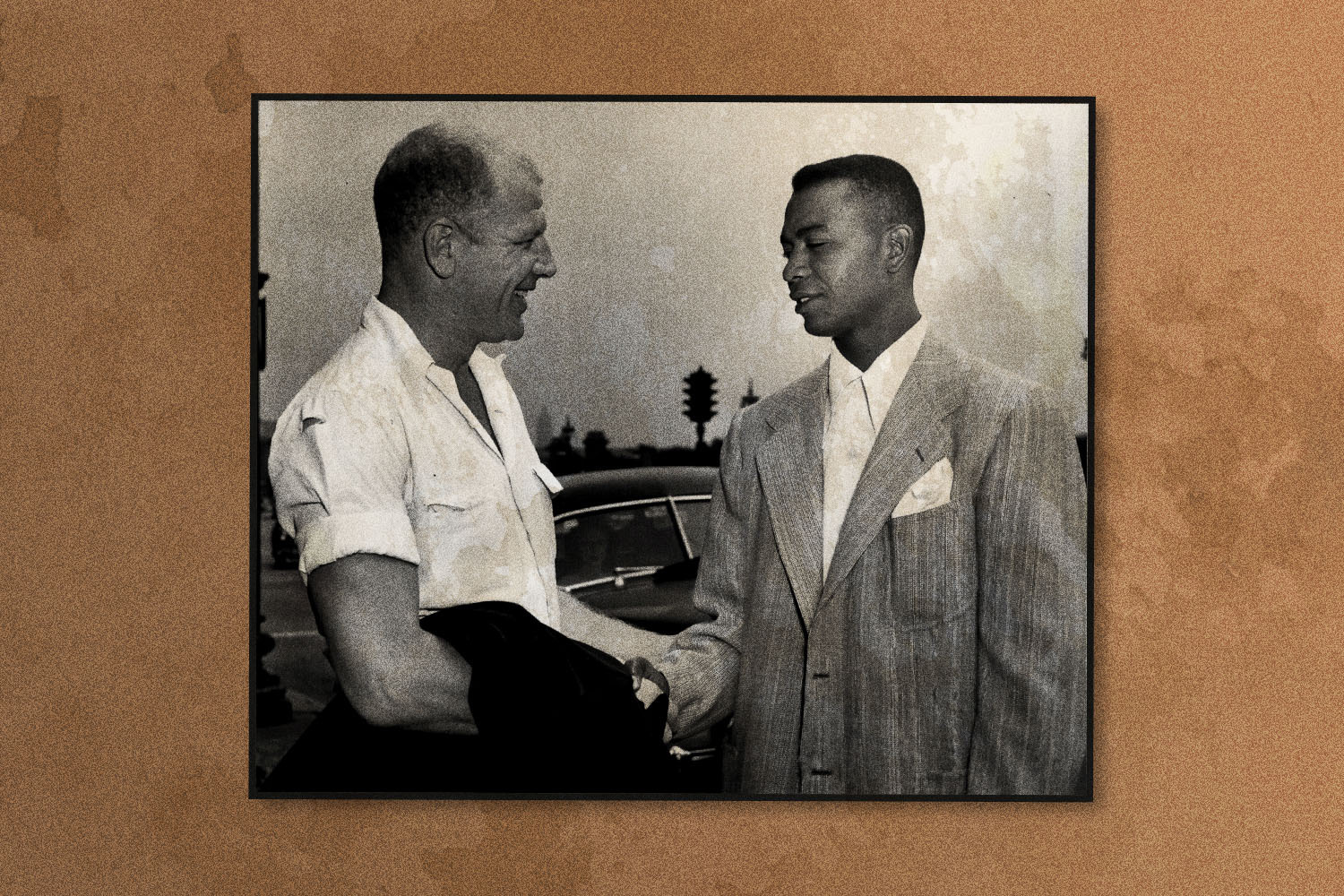 Doby shakes hands with his new boss, President Bill Veeck of the Cleveland Indians', after arriving in Chicago