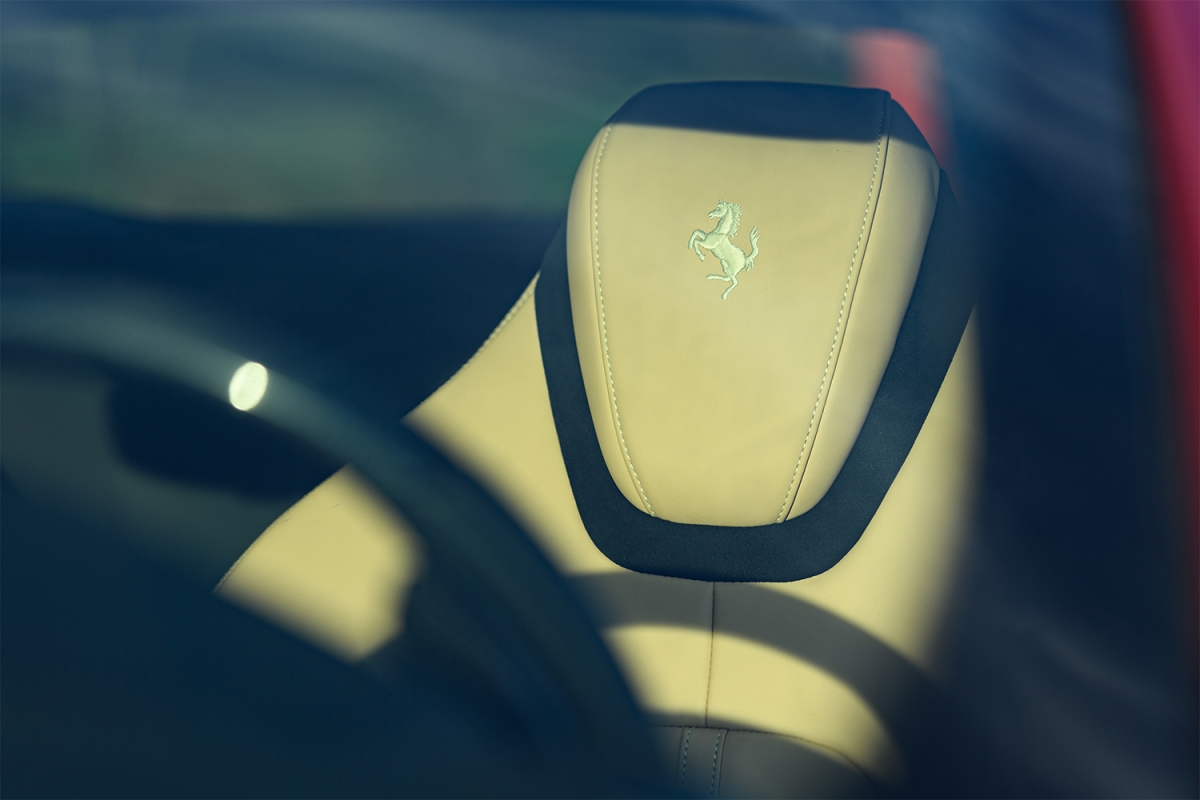 Ferrari Prancing Horse logo on the headrest of the Roma