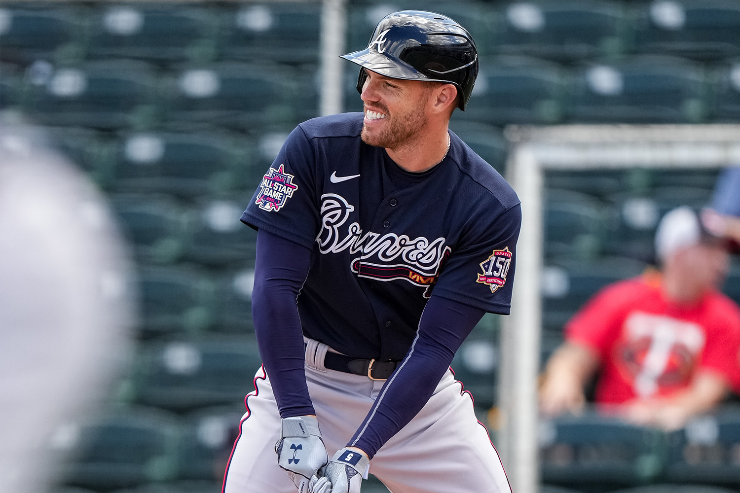 Freddie Freeman #5 of the Atlanta Braves looks on and smiles during a spring training game against the Minnesota Twins